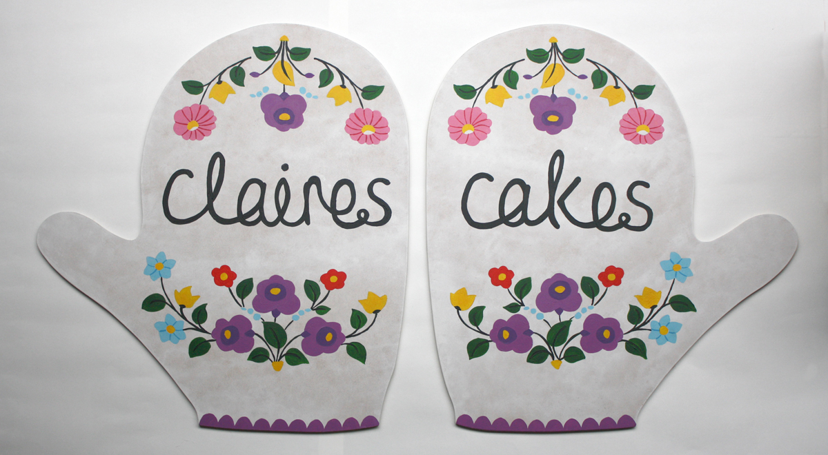 Claire's Cakes Oven Gloves Sign